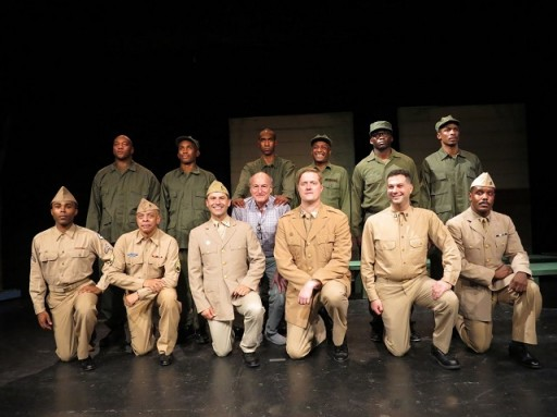 """Peter Friedman, a member of the original cast, surrounded by actors of the Negro Ensemble Company's 50th Anniversary production of """"A Soldier's Play."""" Photo by Jonathan Slaff."""