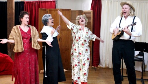 The cast of Bad Quarto Productions' Anna Karenina Lives! (from left to right: Rachel Marie Kemp as Anna Karenina, Kirsten Egenes as Sophia Tolstoy, Brigette Estola as Mae West, and James Overton) sings their curtain number. Written by Germaine Shames. Directed by Tony Tambasco. Costumes by Joanne Famiglietti. Photo by James M. Smith.